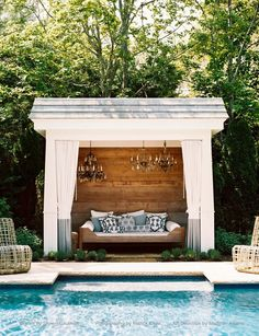 A shaded place to sit by the pool.  Love the chandeliers.