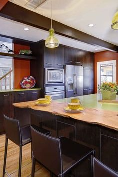 orange kitchen with dark cabinets