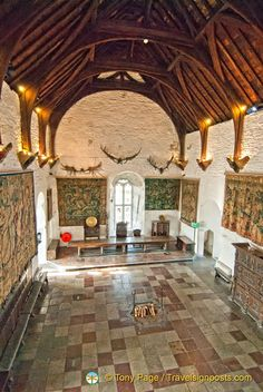 The Great Hall of Bunratty Castle. Bunratty Castle is a large tower house in County Clare, Ireland. It lies in the centre of Bunratty villiage. The present structure is the fourth castle to stand on the site. It was built by the MacNamara family around 1425