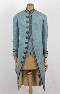 French gentleman's or boy's silk coat & waistcoat, 1780s-1790s. What a treat to find an 18th century garment with the original buttons and trim! An inventory description written in French and handsewn onto the lower front corner of the coat states that the fabric is blue moiré silk with silver braid trim and silver buttons. Judging by the small size, the ensemble from a French collection probably belonged to a young man or boy.
