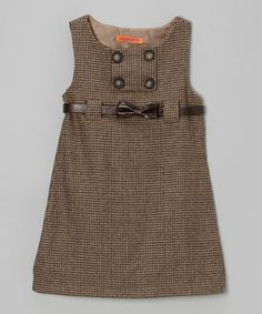 A stylish treat for the fashion-forward girl, this tweed dress boasts a classic A-line silhouette with button detailing. Soft lining and an adjustable belt mean this fanciful frock is as comfy as it is charming.