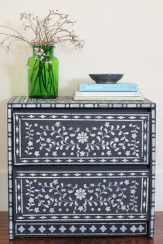 A regular piece of furniture stenciled to look like it has bone/mother of pearl inlay   Vintique Object
