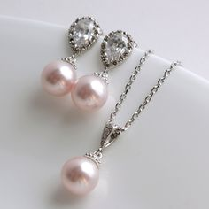Pearl Jewelry Cubic Zirconia Bridal Jewelry Set Silver with Rose Pink Swarovski Pearl Drops Bridesmaid Jewelry Wedding Jewelry. $55.80, via Etsy.