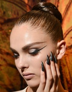 Toronto Fashion Week Spring 2013 backstage beauty: Tight, lacquered hair and graphic cat-eye liner at Greta Constantine