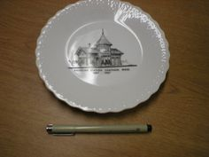 "From the archives of Chatham Historical Society: Small white china souvenir plate with black and white transfer ""Railroad Station, Chatham, Mass. 1887-1987"". #atwoodhouse, #chatham, #plate, #railroadstation, #capecod, #chathamhistoricalsociety"