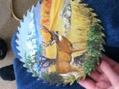 A painting of a deer on a saw blade
