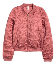 Light brick. Satin bomber jacket with a quilted floral pattern. Zip at front, side pockets, and ribbing at neckline, cuffs, and hem. Lined.
