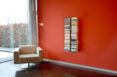 BOOKSBAUM: your books, but also CDs or DVDs appear to be floating, held up in the room by invisible hands. buy at RADIUS DESIGN https://www.radius-design.com/booksbaum1-wall-small-black.html #shelf #invisible #design #interior