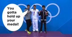 LOL micheal phelps had to tell him to hold up his medal , click on the picture.