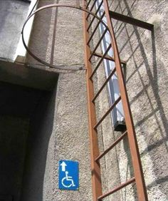 Introducing the Wheelchair Ladder!  (find more funny signs at funnysigns.net)