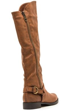 Tall brown boot, with outside zipper detail. Strappy buckle detail around heel. Slightly taller front, comes right below the knee. FINAL SALE