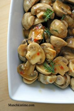 EASY marinated mushrooms- mushroom and zesty italian dressing. THATS IT! Wash half mushroom. Put in a pot on stove with dressing and boil for 10 to 15 minutes. Let cool and enjoy!