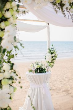 Beautiful outdoor summer wedding ceremony on the beach under a wedding canopy. Wedding cocktail table decorations from CV Linens for wedding decorations on a budget. Click to shop our collection of tablecloths, canopy draping, pipe and drapes, artificial flowers and more! Beach wedding inspiration. #cocktailtabledecor #cocktailtables #cocktailtableswedding #cocktailtablecenterpieces #beachwedding Wedding Ceremony Arch, Beach Wedding Reception, Wedding Canopy, Simple Beach Wedding, Beach Wedding Colors, Summer Wedding, Beach Wedding Centerpieces, Wedding Ideas, Wedding Favors