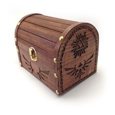 - Small jewelry box - Laser engraved - Stained and sealed - Made of wood - Great for storing rupees Zelda themed Treasure Chest Jewelry Box This wooden chest is engraved with the classic hyrule symbol