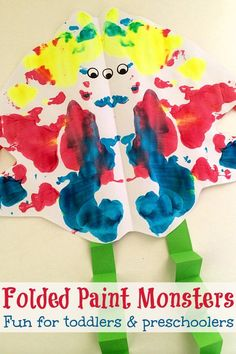 Folded Paint Monsters: Creative Halloween art activity idea for toddlers and preschoolers. Or a fun introduction to learning about symmetry.
