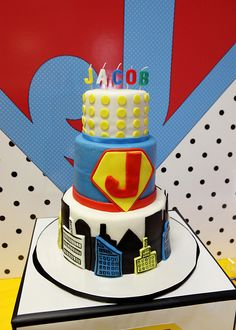 """A gorgeous superhero cake with vintage pop art details. LOVE not sure Badger would think it is """"cool """" enough maybe i could add spiderman batman captain america figures around the table or cakestand"""