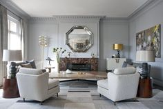 Right Bank Paris living room with custom fireplace, mirror and table by Deniot  Living  Eclectic  Modern  Transitional by JeanLouis Deniot