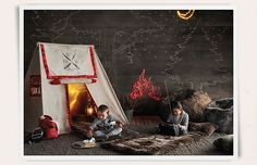rustic american holiday camping with soft furry throws, faux-lit fireplace, chalk drawings, and tents. perfect for winter sleepovers... from Restoration Hardware Baby & Child
