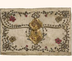 Wallet, metal sequins & thread on silk, 18th c. The handmade sequins used on this piece are silver.