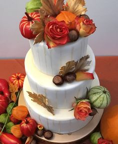 The Cake Lab Bakery, Ranelagh, Dublin, Ireland. Artisan Baking Studio.   Autumn / fall colours inspired 3 tier wedding cake, with Roses, chestnuts and fondant leaves.