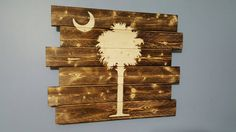 This gorgeous sign is crafted using the technique of wood burning to give it a beautiful rustic appearance. It also comes ready to easily South Carolina Flag, Palmetto Tree, Hanging Wire, Flag Art, Rustic Wall Art, Diy Signs, Pallet Ideas, Myrtle, My Happy Place