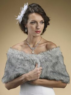 A luxurious and gorgeous vintage inspired Faux Fur Wrap in Grey Chinchilla that will offer you both warmth and glamour at any holiday party, bridesmaids, wedding, prom or special occasion.