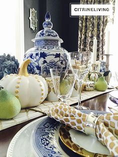 CitrineLiving - A Fall tablescape with rich layers of blue and gold create a…