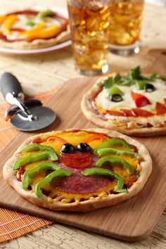 Spooky spider pizza. A cute dinner for kids on Halloween. Doing this with Anthony this year