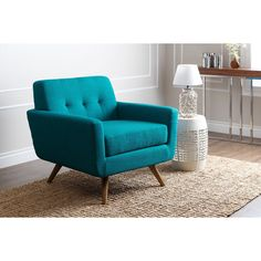 Enjoy this chair for years to come. This stylish blue linen fabric armchair features a deep seat design and a beautiful modern finish. Constructed with a hardwood frame for durability and turfed back design for style.