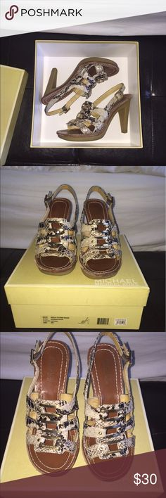 "Michael Kors Molly Platform Snakeskin heels Michael Kors Molly Platform Snakeskin 4"" heels with box.  Slightly worn but in great condition.  Sooo comfortable! MICHAEL Michael Kors Shoes Heels"
