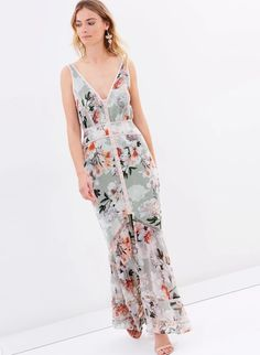 Magnolia Blouson Maxi Dress. A gorgeous maxi dress by We Are Kindred. An exclusive floral print dress featuring a scooped v-neckline, blouson bodice and fitted skirt.