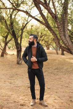 Robert from New Darlings styles the padded jacket with a thermal top over a denim shirt, jeans, and suede boots.