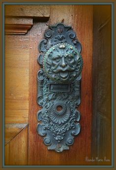 Antique door knob and plate features a half lion half human head and face posted on Flickr by Rhonda Marie Rose