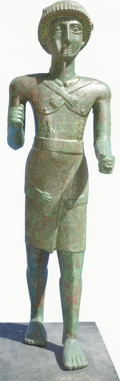 Bronze figure of a man wearing an elaborate outfit of kilt and anima skin, with dagger in his waistband. South Arabian, 1st century CE.
