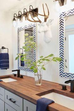 Bathroom Decor countertop Blue chevron mirrors, white bathroom cabinets and butcher block counter Wood Counter Bathroom, White Bathroom Cabinets, Bathroom Countertops, Bathroom Vanities, Ikea Bathroom, Simple Bathroom, Bathroom Furniture, Bathroom Ideas, Hgtv Dream Homes