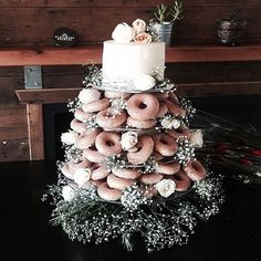 Regram: @onedaybridal  How perfect is this arrangement?! Swoon!! @nellems created this beautiful donut + cake for her brother-in-law's wedding in Torquay.