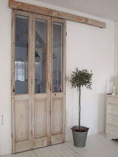 porte-fenetre-patinee-a-recycler-en-cloison-coulissante. Salvaged Doors, Old Doors, Windows And Doors, Sliding Doors, Entry Doors, Sliding Cupboard, Cupboard Doors, Interior Barn Doors, French Country Decorating