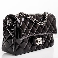 Chanel Black Quilted Patent Small Classic Flap Bag | From a collection of rare vintage shoulder bags at https://www.1stdibs.com/fashion/handbags-purses-bags/shoulder-bags/