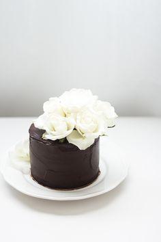 Chocolate mud cake with ganache & white roses
