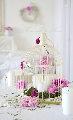 Another cute idea on how to make good use of a birdcage.
