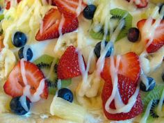 Fruit Pizza Pizzazz! I use this recipe, however, with a sugar cookie crust and crushed pineapple. Make sure the pineapple is well drained. If you are taking it to an event... go to the local pizzeria and purchase a box to carry it in. If it will be more than a few hours until it is served assemble at the event. This is always a requested hit!