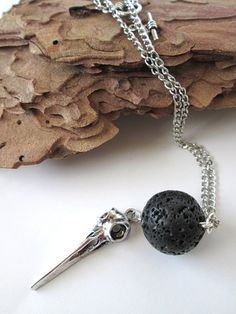 Lava rock with silver bird skull pendant by PepperboxCreations, $17.00