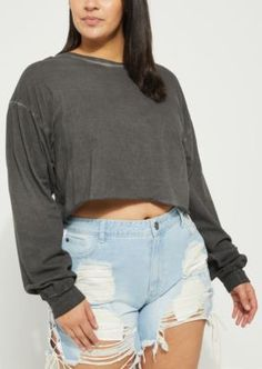 A long sleeve black wash crop top featuring ribbed knit cuffs and a raw cut hemline.