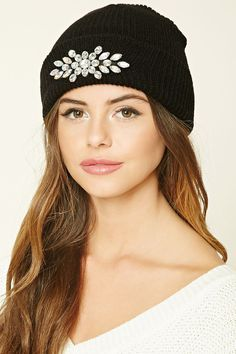 A ribbed knit beanie featuring a rhinestone embellishment and a fold-over design.