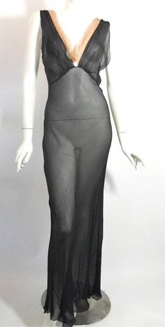 Sheer black bias cut 1940s nightgown with ecru trim at plunging neckline front and back. Textured silk chiffon.