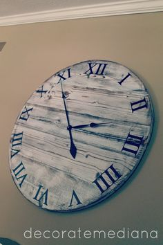 Decorate Me Diana: Pottery Barn Knock-Off Clock-She printed out the numbers and modge-podged them on.