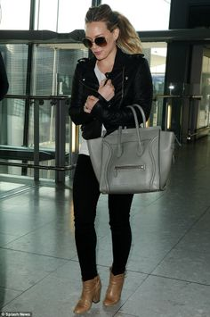 Jet set: Hilary Duff was seen arriving at Heathrow airport less than 48hours in the UK