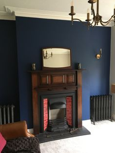 Dulux Sapphire Salute with mahogany 1920's fireplace and reproduction cast iron radiators.