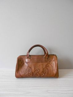 Love stuff like this! vintage tooled brown leather handbag // aztec western by simplychi