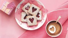 Crumbly, nutty cookies layered with sweet cherry jam and dusted with sugar make delectable valentines. If you're feeling soft-hearted, serve these alongside Hot Chocolate with Marshmallow Hearts.